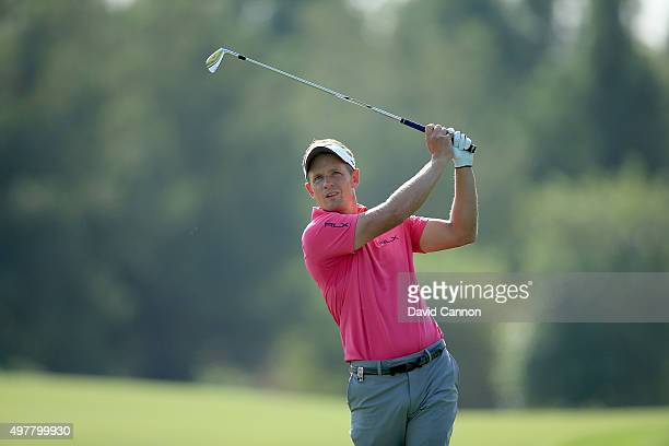 Luke Donald of England plays his second shot on the par 4 third hole during the first round of the 2015 DP World Tour Championship on the Earth...
