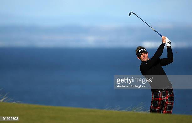 Luke Donald of England plays his second shot to the fifth hole during the third round of The Alfred Dunhill Links Championship at Kingsbarns Golf...