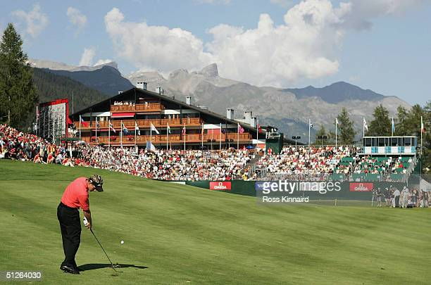 Luke Donald of England plays his second shot to the par four 18th hole during the final round of The Omega European Masters at Crans-Sur-Sierre Golf...