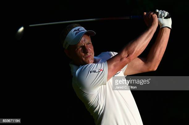 Luke Donald of England plays his tee shot on the second hole during the first round of the Wyndham Championship at Sedgefield Country Club on August...
