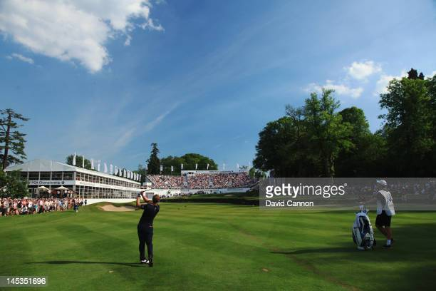 Luke Donald of England plays into the 18th green during the final round of the BMW PGA Championship on the West Course at Wentworth on May 27 2012 in...