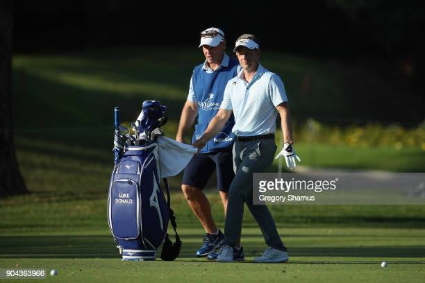 Luke Donald of England prepares to play a shot on the eighth hole during round two of the Sony Open In Hawaii at Waialae Country Club on January 12...
