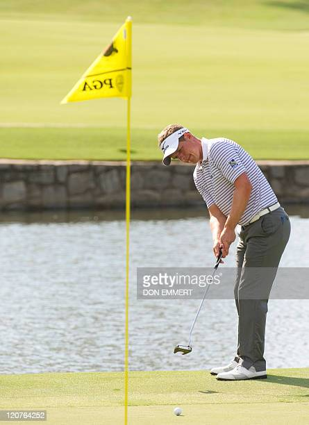 Luke Donald of England putts on the 18th green during a practice round of the 2011 PGA Championship Tournament at Atlanta Athletic Club August 9 2011...