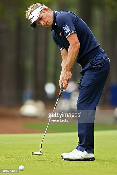Luke Donald of England putts on the 2nd green during the final round of the RBC Heritage at Harbour Town Golf Links on April 20 2014 in Hilton Head...