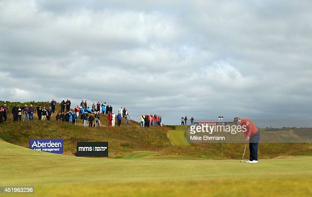 Luke Donald of England putts on the seventh hole during the 2014 Aberdeen Asset Management Scottish Open at Royal Aberdeen on July 10 2014 in...