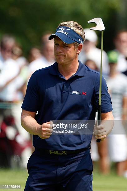 Luke Donald of England reacts after he made a birdie putt on the ninth hole during the second round of the Deutsche Bank Championship at TPC Boston...