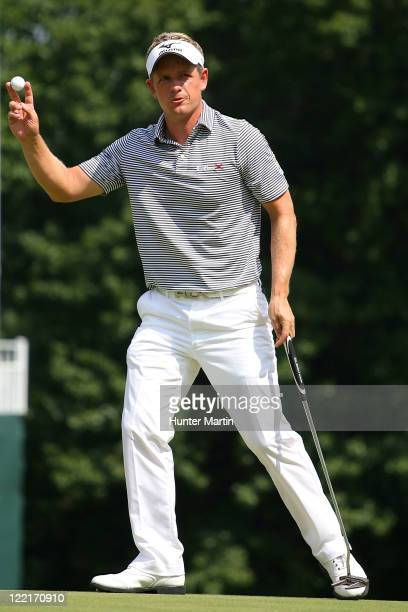 Luke Donald of England reacts after he made a putt a birdie on the 18th hole during round two of The Barclays at Plainfield Country Club on August...