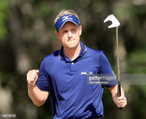 Luke Donald of England reacts after making a birdie putt on the 14th hole during the final round of the Children's Miracle Network Classic at...