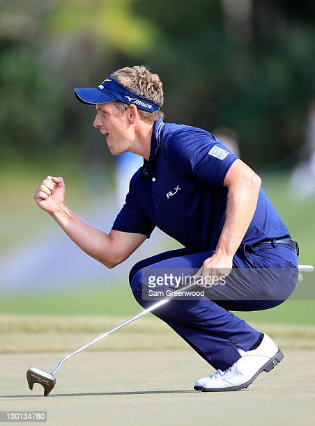 Luke Donald of England reacts after making a birdie putt on the 15th hole during the final round of the Children's Miracle Network Classic at...