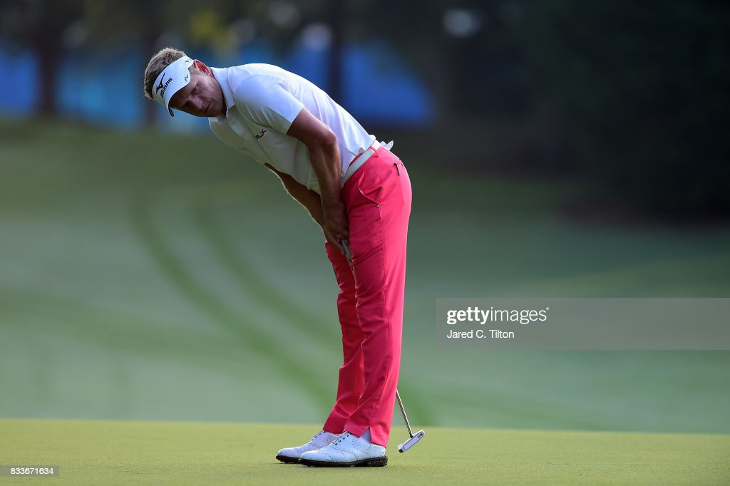 Luke Donald of England reacts after missing his birdie putt on the first green during the first round of the Wyndham Championship at Sedgefield Country Club on August 17, 2017 in Greensboro, North Carolina.