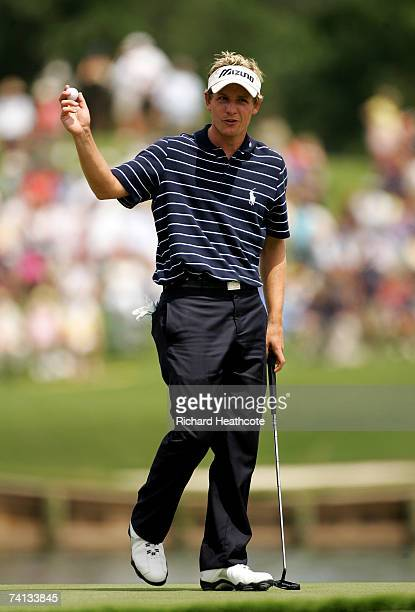 Luke Donald of England reacts to a putt on the 17th green during the third round of THE PLAYERS on The Stadium Course at the TPC Sawgrass on May 12...
