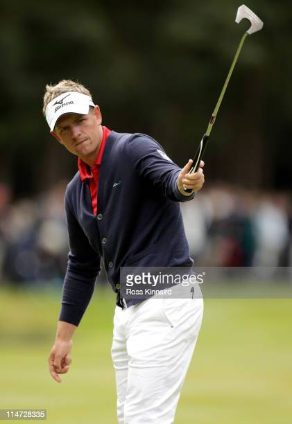 Luke Donald of England reacts to his birdie putt on the 13th green during the first round of the BMW PGA Championship at Wentworth Club on May 26,...