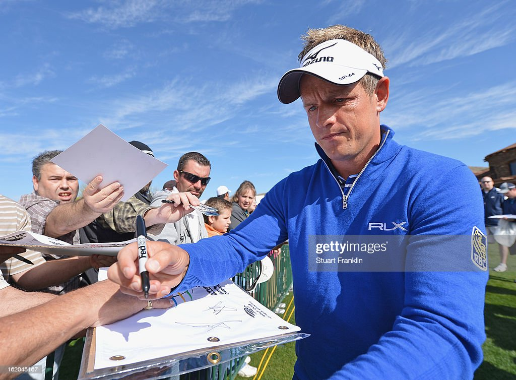 Luke Donald of England signs an autograph during practice prior to the start of the World Golf Championships-Accenture Match Play Championship at the Ritz-Carlton Golf Club on February 18, 2013 in Marana, Arizona.