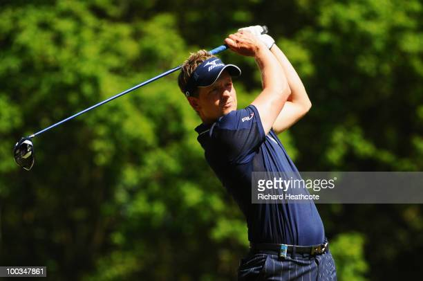 Luke Donald of England tees off at the 3rd hole during the final round of the BMW PGA Championship on the West Course at Wentworth on May 23 2010 in...
