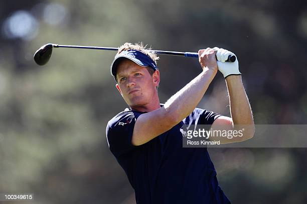 Luke Donald of England tees off at the 8th hole during the final round of the BMW PGA Championship on the West Course at Wentworth on May 23 2010 in...