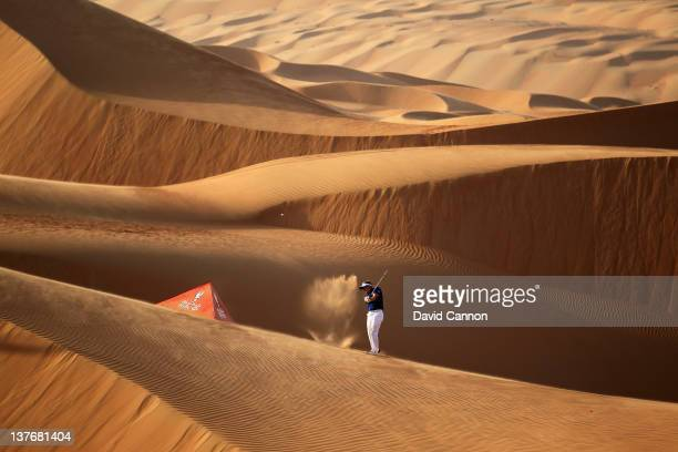 Luke Donald of England the World's Number One golfer plays from amongst the 250ft high sand dunes in Abu Dhabi's Liwa Desert at the entrance to Rub...