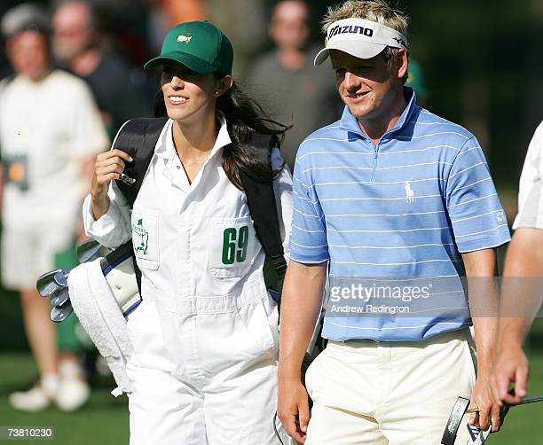 Luke Donald of England walks with his fiance Diane Antonopoulos during the Par3 contest prior to the start of The Masters at the Augusta National...