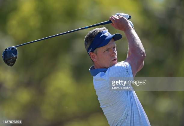 Luke Donald of England watches his tee shot on the 18th hole during the second round of the Valspar Championship on the Copperhead course at...