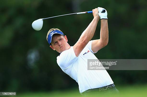Luke Donald of England watches his tee shot on the ninth hole during the second round of the TOUR Championship at East Lake Golf Club on September 23...