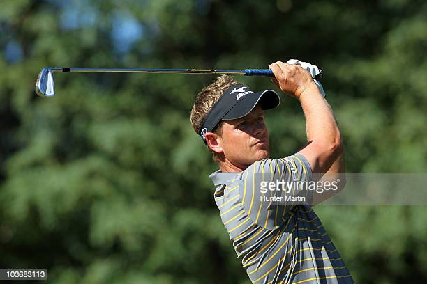 Luke Donald of England watches his tee shot on the second hole during the second round of The Barclays at the Ridgewood Country Club on August 27...