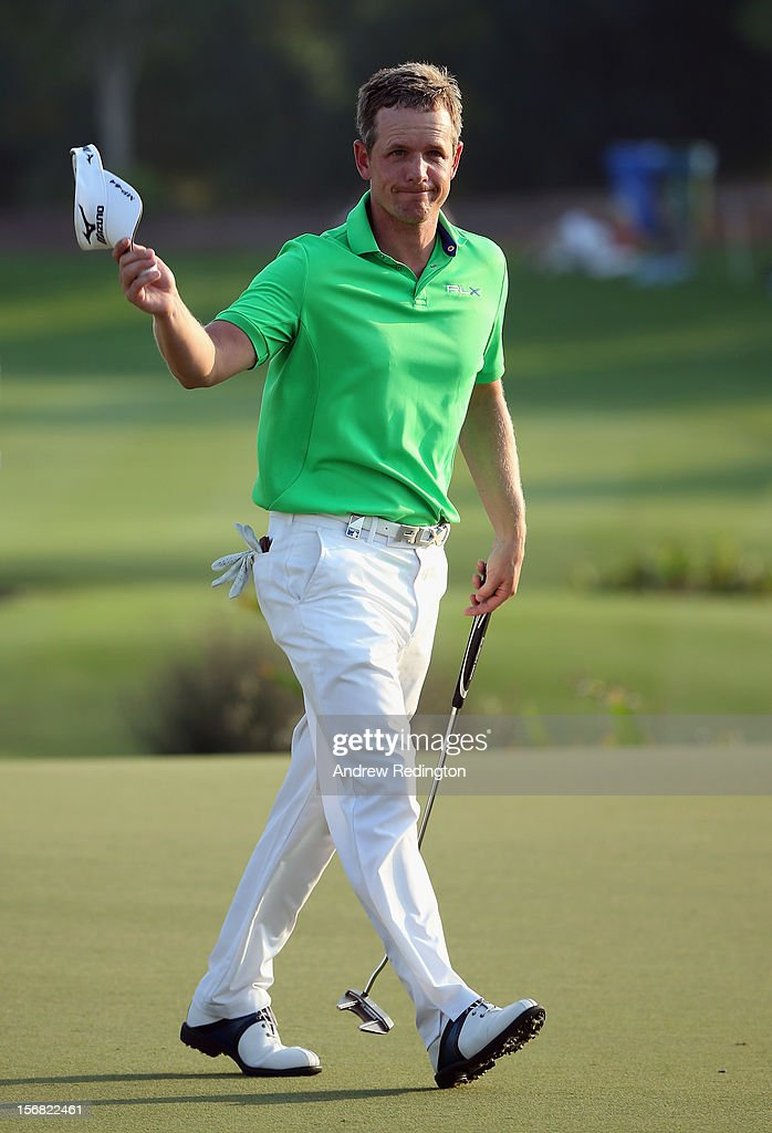 Luke Donald of England waves to the crowd on the 18th green during the first round of the DP World Tour Championship on the Earth Course at Jumeirah Golf Estates on November 22, 2012 in Dubai, United Arab Emirates.