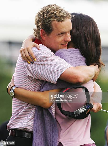 Luke Donald of Europe celebrates winning his singles match against Chad Campbell of USA on the 17th green with fiancee Diane Antonopoulos on the...