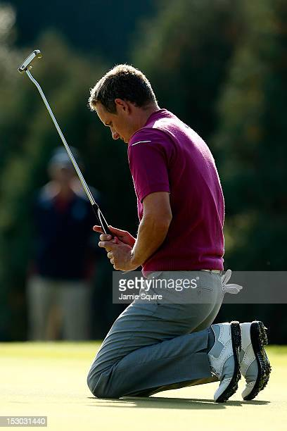 Luke Donald of Europe drops to his knees on the tenth green during day two of the Morning Foursome Matches for The 39th Ryder Cup at Medinah Country...