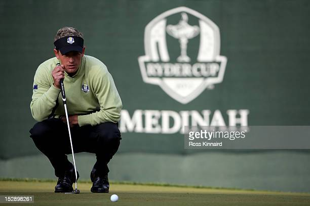 Luke Donald of Europe lines up a putt during the Morning Foursome Matches for The 39th Ryder Cup at Medinah Country Club on September 28 2012 in...