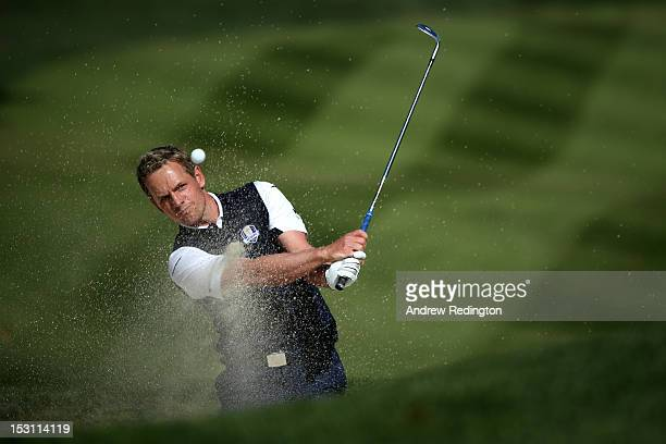Luke Donald of Europe plays a bunker shot on the fifth hole during the Singles Matches for The 39th Ryder Cup at Medinah Country Club on September...