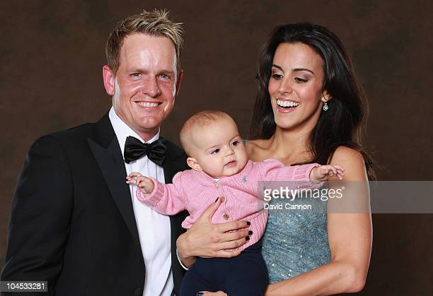 Luke Donald of the European Ryder Cup team poses with his wife Diane and their daughter Elle prior to the 2010 Ryder Cup Dinner at the Celtic Manor...