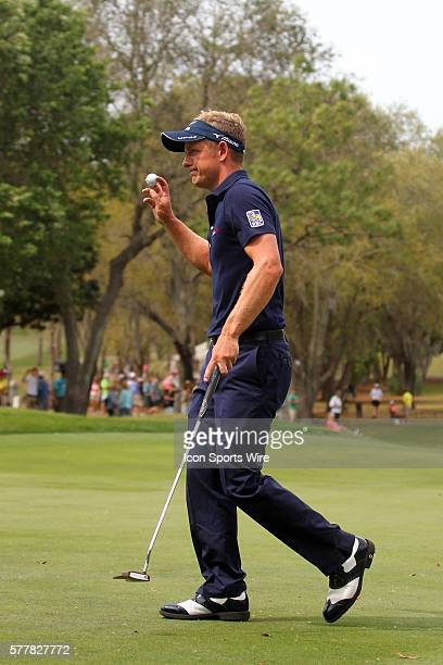 Luke Donald thanks the fans after making a putt during the final round of the Valspar Championship at Innisbrook Resort - Copperhead in Palm Harbor,...