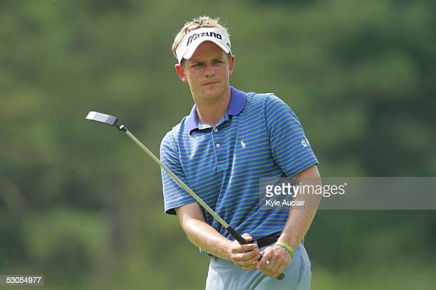 Luke Donald watches his putt at the 15th hole during the third round of the Booz Allen Classic on June 11 2005 at Congressional Country Club in...