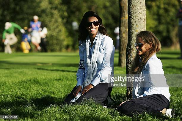 Luke Donald's fiancee Diane Antonopoulos watches the action with Sergio Garcia's girlfriend Morgan Norman during the morning fourballs of the first...