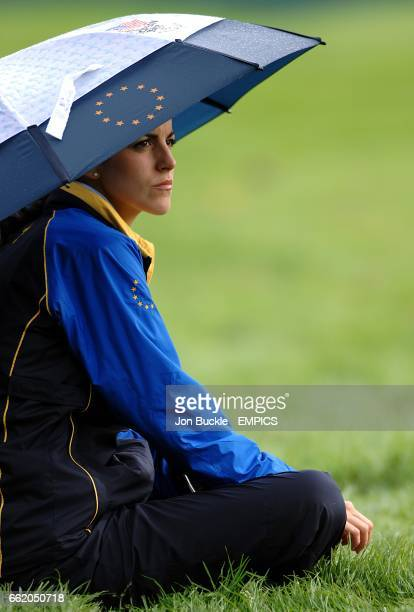 Luke Donald's girlfriend Diane Antonopoulos shelters from the rain