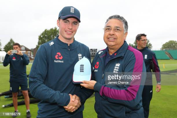 Luke Doneathy of England U19 is presented with his debut cap by John Abrahams England U19 Selector during the TriSeries match between England U19 and...