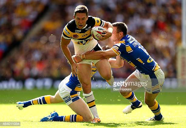 Luke Dorn of Castleford is tackled by Liam Sutcliffe and Kevin Sinfield of Leeds during the Tetley's Challenge Cup Final between Leeds Rhinos and...