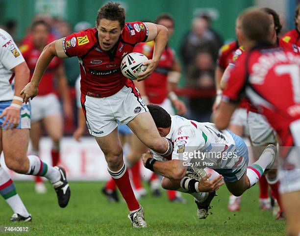 Luke Dorn of Salford City Reds is tackled by Henry Paul of Harlequins RL during the Engage Super League match between Salford City Reds and...