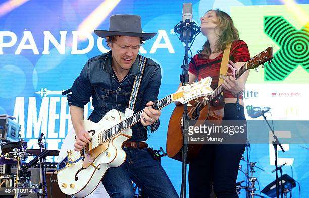 Luke Doucet and Melissa McClelland of Whitehorse onstage during the PANDORA Discovery Den SXSW on March 20 2015 in Austin Texas
