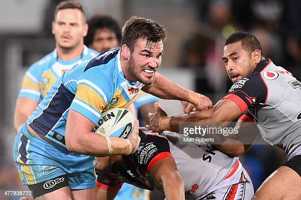 Luke Douglas of the Titans takes on the defence during the round 15 NRL match between the Gold Coast Titans and the New Zealand Warriors at Cbus...