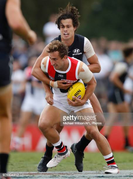 Luke Dunstan of the Saints and Jack Silvagni of the Blues in action during the AFL 2018 JLT Community Series match between the Carlton Blues and the...