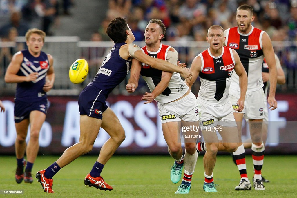 Luke Dunstan of the Saints handballs during the round eight AFL match between the Fremantle Dockers and the St Kilda Saints at Optus Stadium on May 12, 2018 in Perth, Australia.