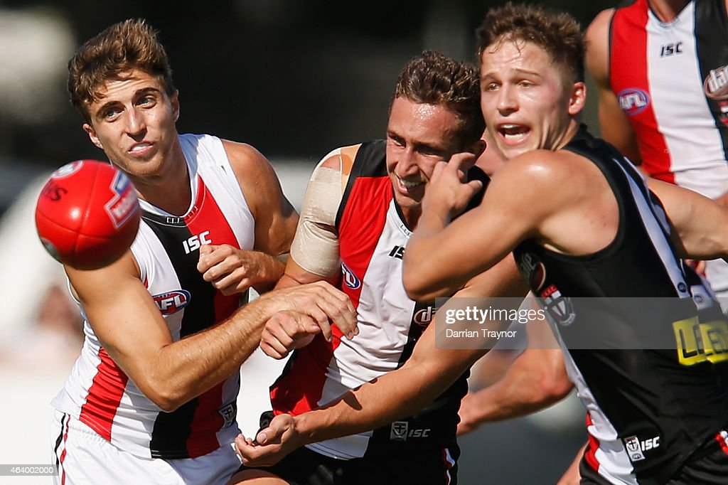 Luke Dunstan of the Saints handballs during the St Kilda Saints AFL intra club match at Linen House Oval on February 21, 2015 in Melbourne, Australia.