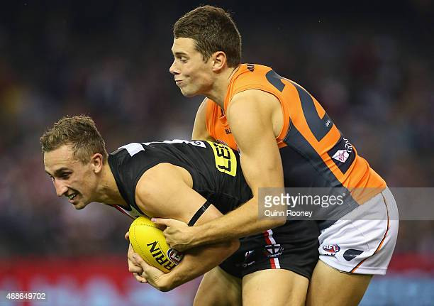 Luke Dunstan of the Saints is tackled by Joshua Kelly of the Giants during the round one AFL match between the St Kilda Saints and the Greater...
