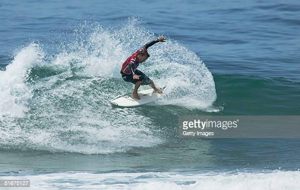 Luke Egan of Australia slashes a frontside turn en route to defeating Adriano De Souza and Raoni of Brazil on November 4 2004 at the Fosters ASP Nova...