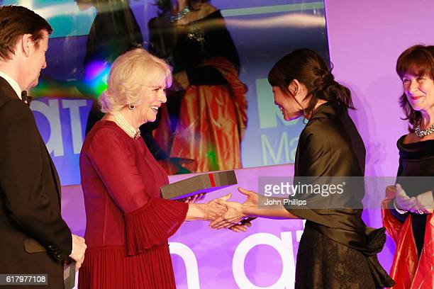 Luke Ellis Camilla Duchess of Cornwall and Helena Kennedy QC present shortlisted author Madeleine Thien with a copy of her book 'Do Not Say We Have...
