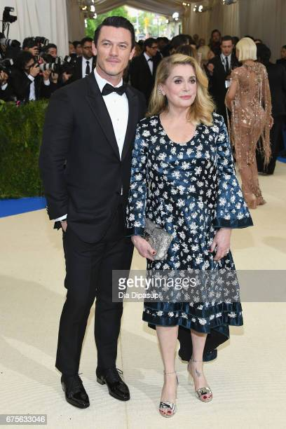 Luke Evans and Catherine Deneuve attend the 'Rei Kawakubo/Comme des Garcons Art Of The InBetween' Costume Institute Gala at Metropolitan Museum of...