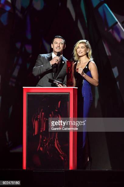 AWARDS 2018 *** Luke Evans and Hailey Baldwin on stage at The BRIT Awards 2018 held at The O2 Arena on February 21 2018 in London England