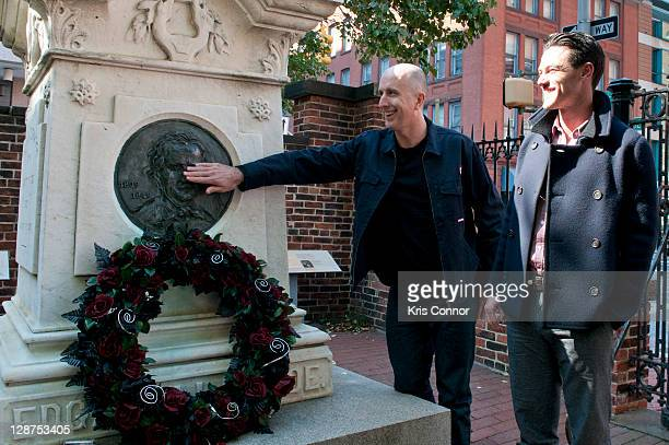 Luke Evans and James McTeigue lay a wreath on the grave of Edgar Allan Poe on the 162nd anniversary of his death at Westminster Hall on October 7,...