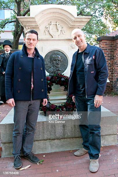 Luke Evans and James McTeigue pose for a photo after laying a wreath on the grave of Edgar Allan Poe on the 162nd anniversary of his death at...