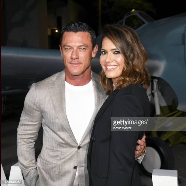 Luke Evans and Mandy Moore attend the premiere of Lionsgates' Midway at Regency Village Theatre on November 05 2019 in Westwood California